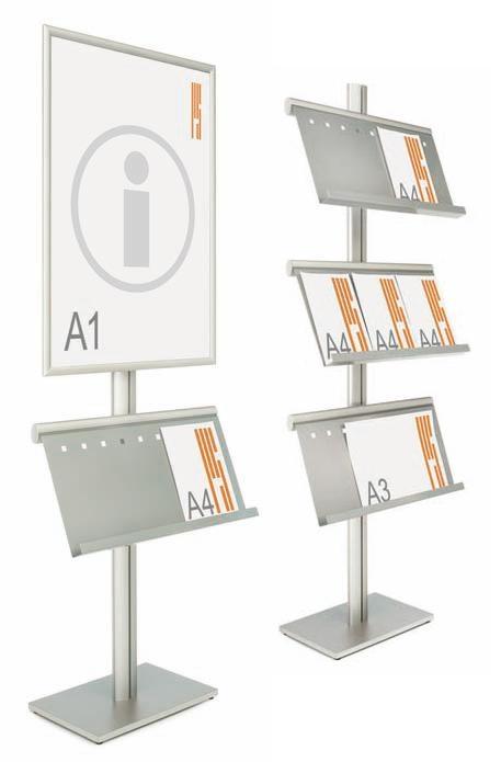 Expositores de información  - Expositores de información. Conjunto formado por un portapósters de formato DIN A1 a una o dos caras y/o porta estantes sobre perfil elíptico vertical de aluminio anodizado plata mate. Disponible portapósters y/o estantes.