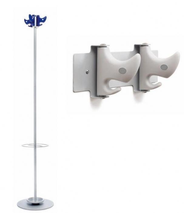 """Percheros - Percheros.  Gama de percheros """"NOM"""", en versión de pié y mural. La versión de pié está disponible en colores standard gris y azul, y la estructura desmontable de aluminio gris está disponible con o sin paragüero. La gama mural disponible en 1, 2 ó 4 perchas."""