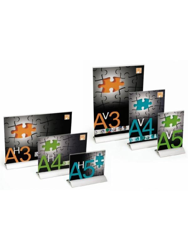 Portacarteles con base de aluminio -  Portacarteles con base de aluminio Expositor portacarteles fabricado en metacrilato transparente de alta resistencia y base de aluminio anodizada en plata mate. La diversidad de formatos; A3, A4, A5, en formato vertical u horizontal, permiten obtener un perfecto soporte para cada documento.